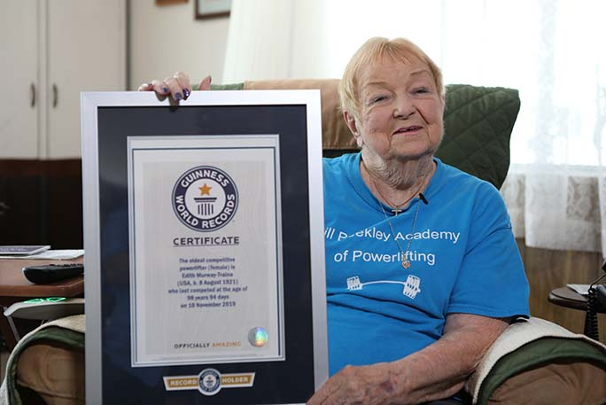 Oldest-competitve-powerlifter-edith-murway-traina-with-her-Guinness-World-Records-certificate