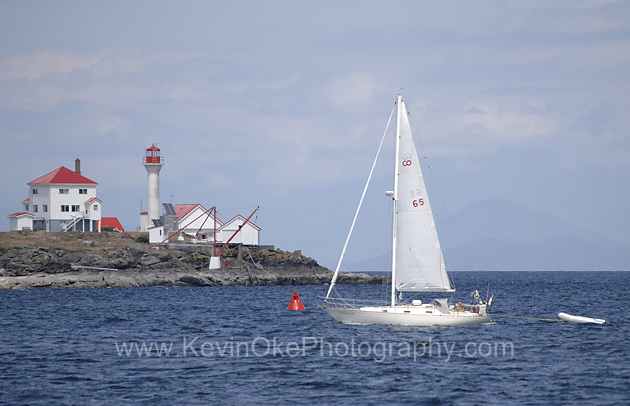 Sailing in front of the  Entrance Island Lighthouse from Berry Point, Gabriola Island, British Columbia, Canada