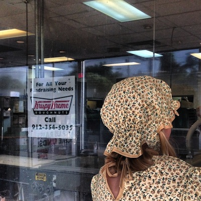 Pioneer Girl at Krispy Kreme