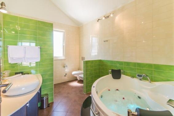 Master bathroom with massage bathtub and shower