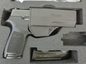 Used Sig Sauer P320 Carry 9mm w/ night sight, extra magazine, holster and case $525