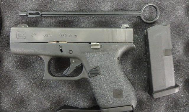 Used Glock 42  380 w/ night sights, extra magazine and case