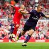 Arsenal's Lukas Podolski celebrates