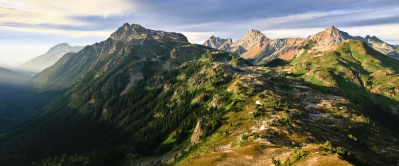 The-Rugged-and-Colorful-Highlands-Directly-North-of-Mt-Baker-North-Cascades-7623-Buff-Black_w940_h392