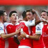 Arsenal players celebrate the opening goal
