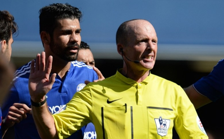 Editorial use only. No merchandising. For Football images FA and Premier League restrictions apply inc. no internet/mobile usage without FAPL license - for details contact Football Dataco  Mandatory Credit: Photo by Javier Garcia/BPI/REX Shutterstock (5111926v)  With Diego Costa of Chelsea by his side referee Mike Dean consults with his linesman before sending off Gabriel Paulista of Arsenal during the Barclays Premier League match between Chelsea and Arsenal played at Stamford Bridge, London on September 19th 2015  Barclays Premier League 2015/16 Chelsea v Arsenal Stamford Bridge, Fulham Rd, London, United Kingdom - 19 Sep 2015