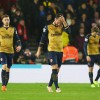 Dejected Players thanks to Wenger
