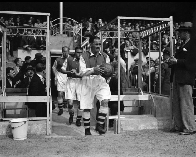 Alex James leads the side out at Highbury