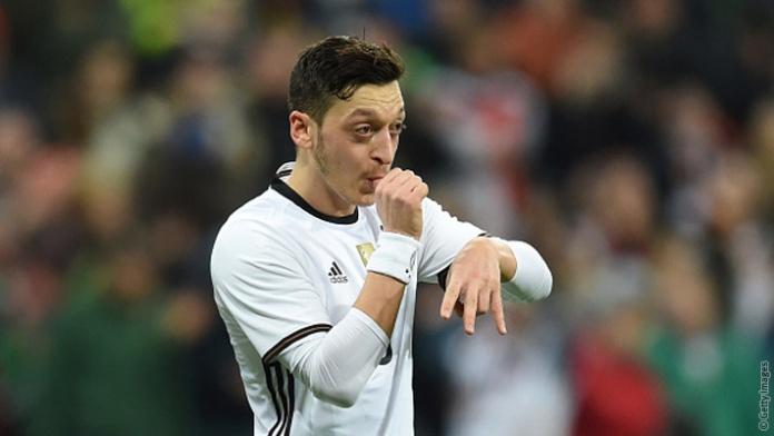 Ozil celebrates a goal in a great tournament
