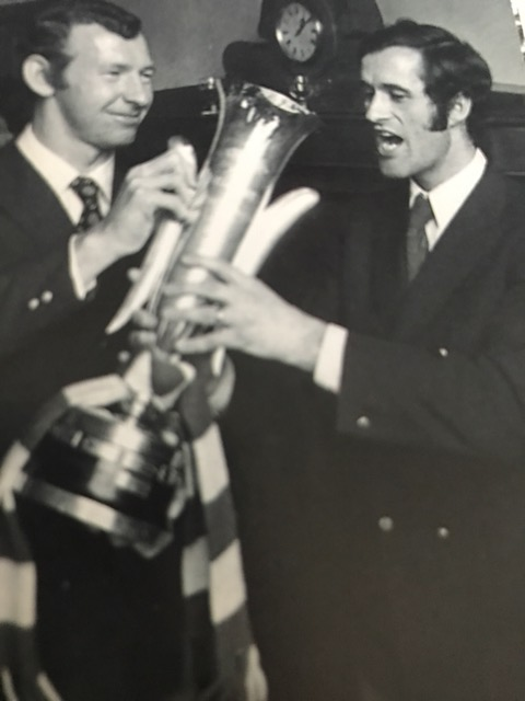 Bob celebrates with George Graham who has a drink from the Fairs Cup