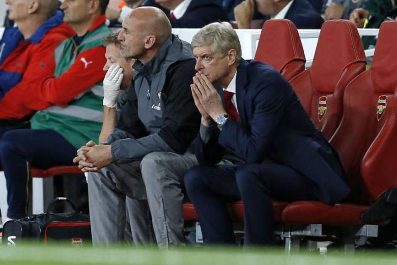 Arsene Wenger watches on