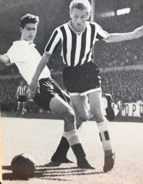 George in his Newcastle days evading a tackle from Spurs Maurice Norman