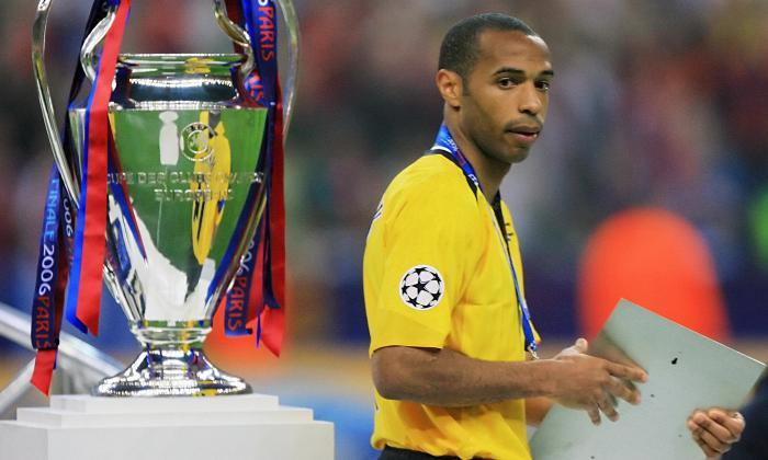 Thierry Henry looks ruefully at the Champions League trophy