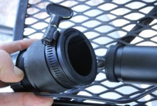 The camera assembly attaches to the back of your scope, so instead of looking through it, you look at the screen.