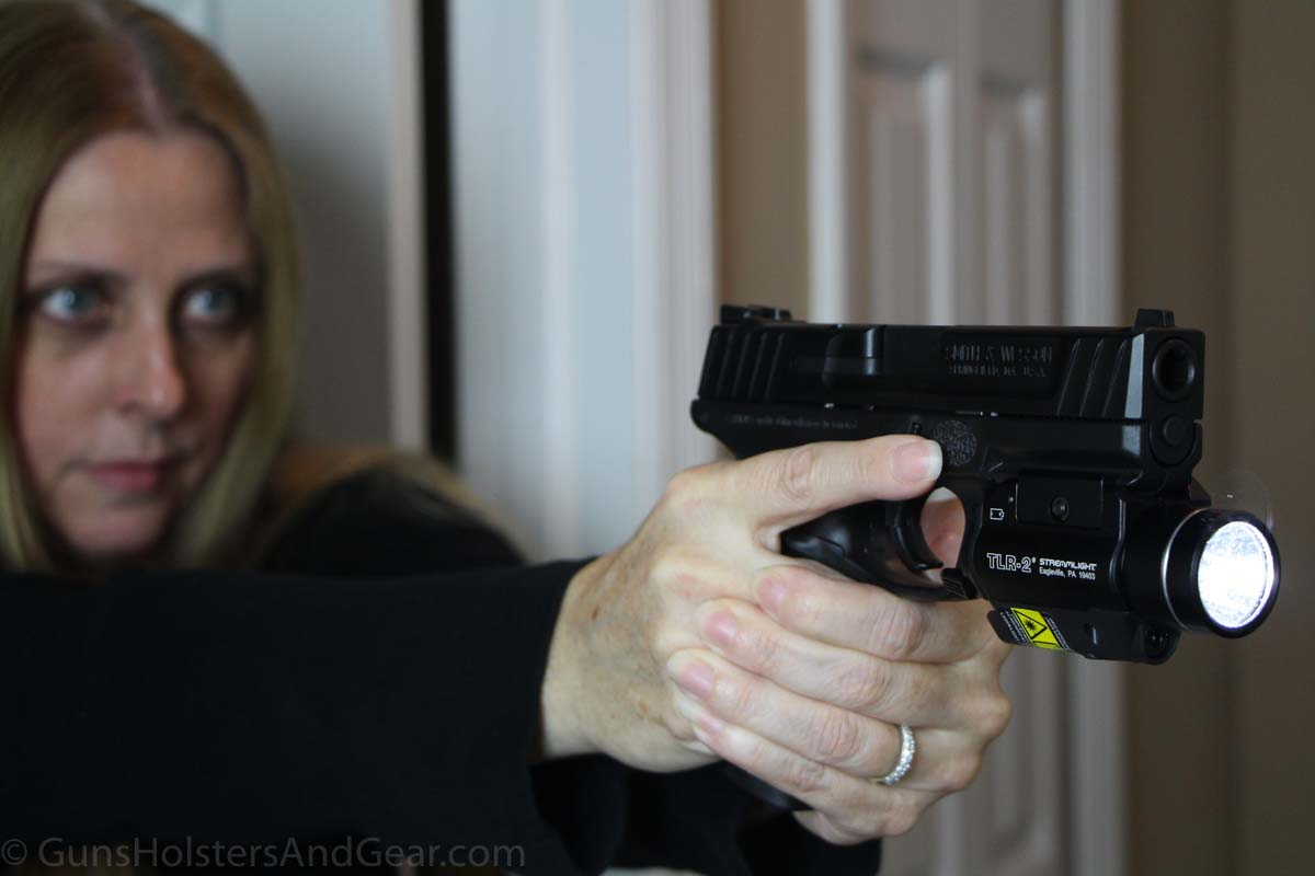 Beautiful Woman Shooting Smith & Wesson SD40 with Weapon Light