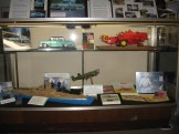 Shows the '57 Mercury, red combine, USS Iowa, and WWII bomber.