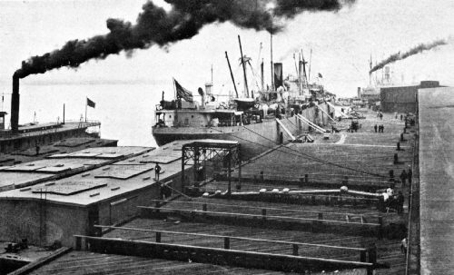 In Foreground—Loading Coffee by Means of an Automatic Traveling-Belt Conveyor, on Government Barges for St. Louis