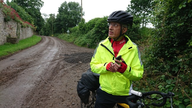Cyclist on a muddy road