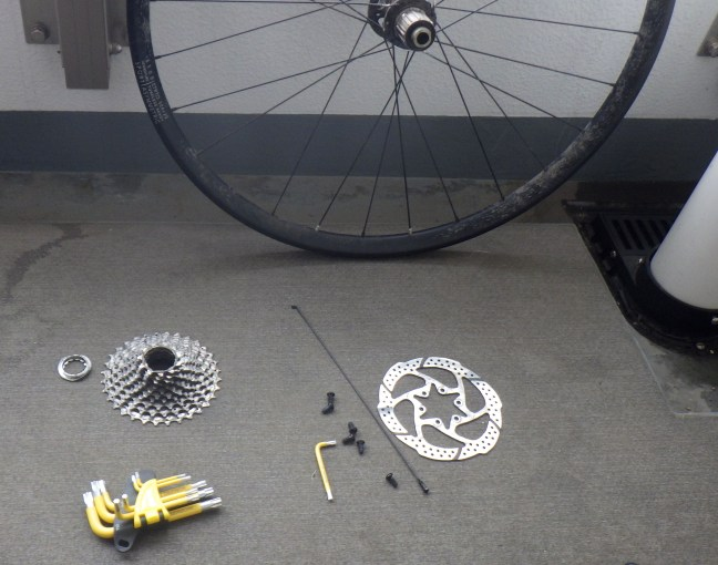 Tools and parts to replace a spoke