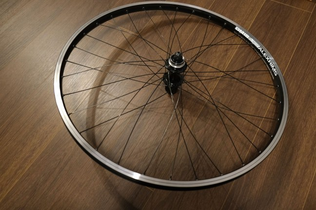 Fully laced bicycle wheel with spokes still loose and bent