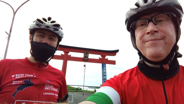 Selfie of two cyclists in front of Haneda peace shrine