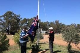Gasworks Volunteers Nicholas Pyers and Joe Belling raising the NSW State Flag at Illabo Motorsport Park -- Illabo Motorsport Park March 10, 2021
