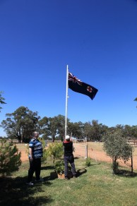 Gasworks Volunteers Nicholas Pyers and Joe Belling raising the NSW State Flag at Illabo Motorsport Park -- Illabo Motorsport Park March 10, 2021