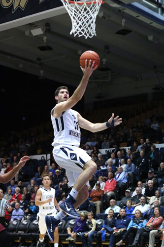 Inside game propels men's basketball to season-opening win ...