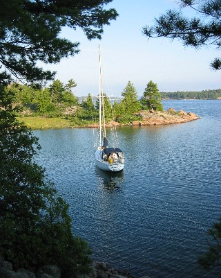 Photo: About Time sitting at anchor, Croker Island, North Channel, Ontario. Credit: L. Borre.