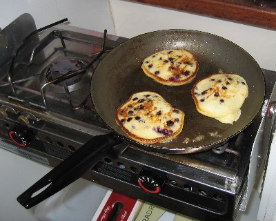Photo: Wild blueberry pancakes on the griddle at Croker Island. Credit: L. Borre.