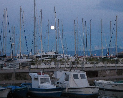 Photo: A full moon rises over the marina in Gaeta, Italy. Credit: Lisa Borre.