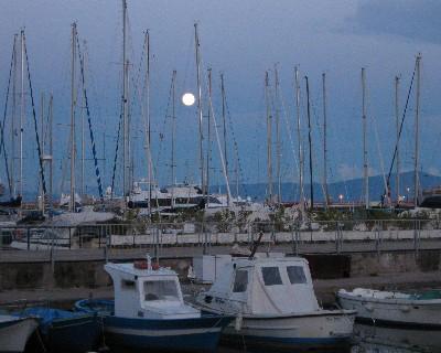 Photo: A full moon rises over the marina in Gaeta, Italy. Credit: Lisa Borre.