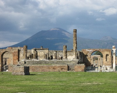 Photo: The Temple of Jupiter at the forum of Pompeii with Mt. Vesuvius in the background. Credit: Lisa Borre.