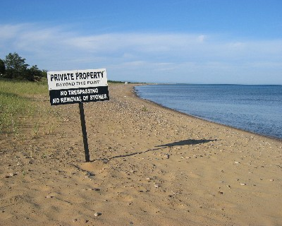 Photo: Private property sign on beach near Whitefish Point, Lake Superior. Credit: L. Borre.