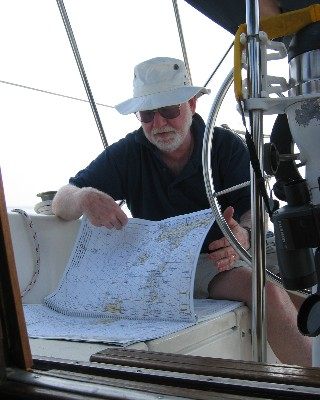 Photo: Our friend Al studies the charts on the way to the Erie Islands. Credit: L. Borre.