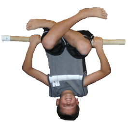 Boy upside down on bar