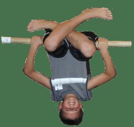 Boy upside down on bar