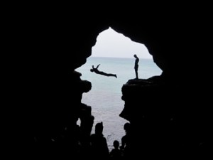 My teenage son took this photo just as the divers were in action. The shape of the cave happens to be the mirror image of Africa with Madagascar next to it! Ironic!