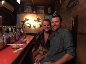 Grant and Rachel at a bar in Golden Gai Tokyo