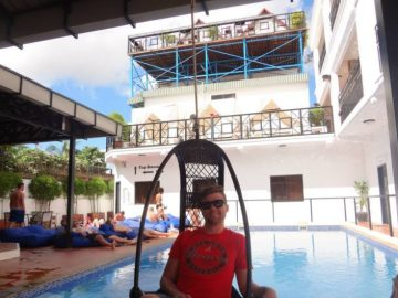 Grant by the pool at the Mad Monkey Hostel