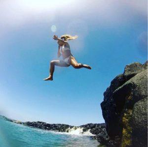 Rachel jumping in at Queen's Bath Kauai