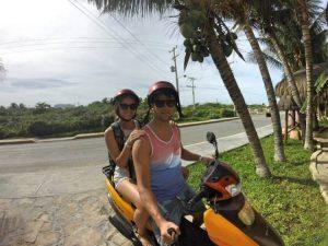Grant and Rachel on moped on Isla Mujeres