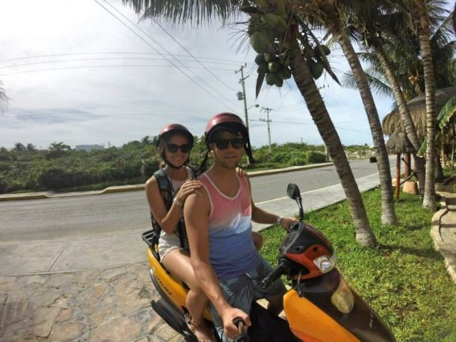 Grant and Rachel on moped on Isla Mujeres