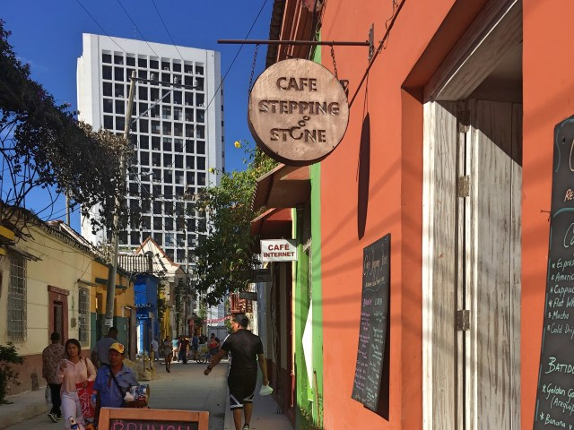 sign outside of cafe stepping stone in cartagena