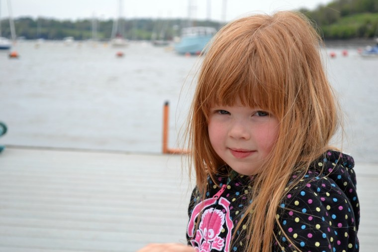 Our daughter on the pontoon waiting to go on our boat