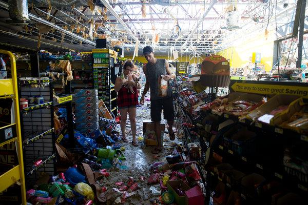photo: residents collect food and supplies from damaged businesses. 'We Need Answers': Hurricane Michael Leaves Florida Residents Desperate for Aid
