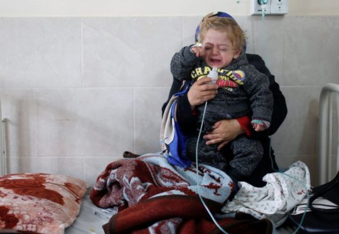 A Palestinian child is held by his mother in Dora hospital in Gaza City, February 6, 2018.