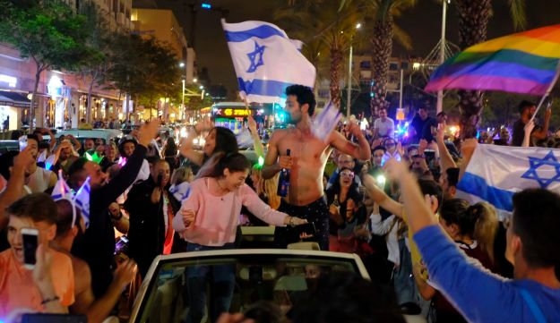 People celebrate in Tel Aviv the winning of the Eurovision Song Contest by Israel's Netta, May 12, 2018.