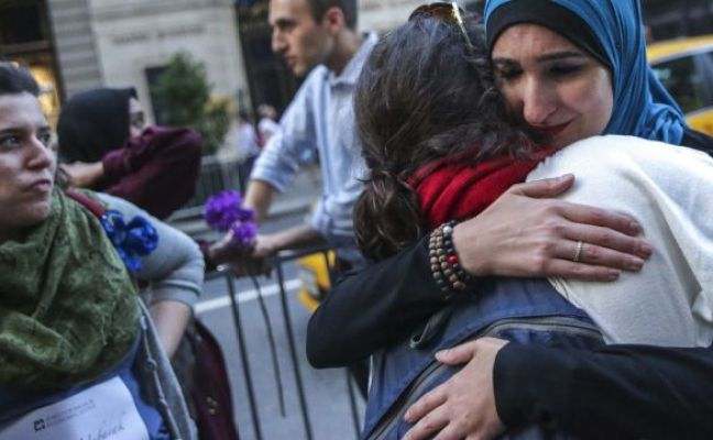 Palestinian-American activist Linda Sarsour, right, hugging a demonstrator during an iftar outside of Trump Tower, New York, June 1, 2017.