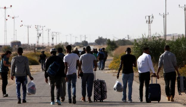 Asylum seekers leaving Saharonim holding facility, April 2018.